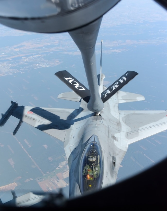 A U.S. Air Force KC- 135 Stratotanker from the 100th Air Refueling Wing refuels a Polish air force F-16 Fighting Falcon in support of exercise One Sky over Poland, Sept. 19, 2018. One Sky exercises focuses on interoperability with our Polish counterparts and enhanced the operational readiness of both nations. (U.S. Air Force photo by Airman 1st Class Alexandria Lee)