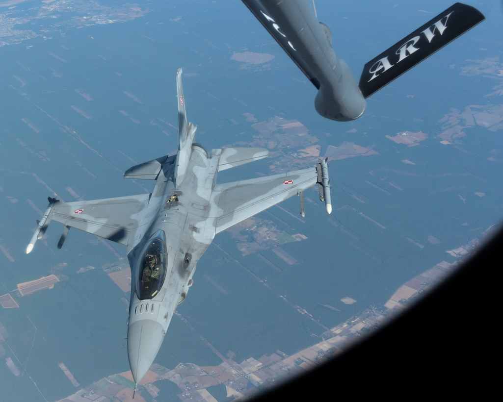 A Polish air force F-16 Fighting Falcon approaches a U.S. Air Force KC-135 Stratotanker from the 100th Air Refueling Wing in support of exercise One Sky over Poland, Sept. 19, 2018. The One Sky exercise is an example of U.S. and NATO allies sharing a commitment to promote peace and stability through developing their relationship and communication process. (U.S. Air Force photo by Airman 1st Class Alexandria Lee)