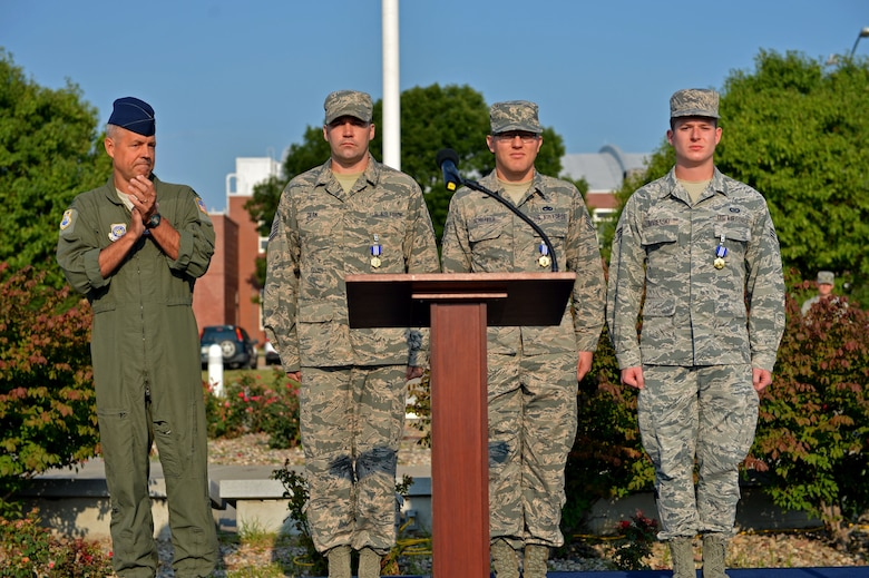Master Sgt. Jeremy Dean, Staff Sgt. Dan Schieffer, and Senior Airman Jonathan Sobetski receive the Nebraska National Guard Commendation Medal Aug. 5, 2018, at the Nebraska National Guard air base, Lincoln, Nebraska. Capt. John Kupka, the commander of the 155th Logistics Readiness Squadron's distribution flight, and Staff Sgt. Matthew Riley, a traffic management operator with the 155th LRS, were not present for the award ceremony.