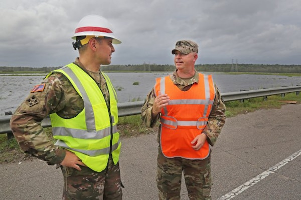 U.S. Army Corps of Engineers, Charleston District Commander, Lt. Col. Jeffrey Palazzini, left, coordinates flood mitigations efforts underway along U.S. Highway 501 in Horry County, S.C., with South Carolina Army National Guard Lt. Col. William A. Matheny, commander, 122 Engineering Battalion, Sept. 16, 2018. Army National Guard engineering units are working here with U.S. Army Corps of Engineers logistics and technical experts in support of FEMA, state and local partners during post-storm recovery operations.