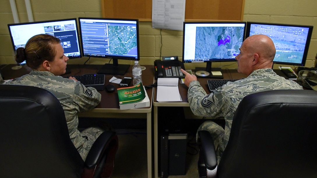 Master Sgts. Twila Costiloe and Jeffery Ames, 188th UPAD analysts, prepare information products in the 188th Unclassified Processing, Assessment, and Dissemination (UPAD) element at Ebbing Air National Guard Base, Ark., to support Hurricane Florence response efforts Sept. 20, 2018.  The UPAD provides graphical information products to incident commanders in affected areas in order to effectively coordinate response efforts.  (U.S. Air National Guard photo by Staff Sgt. Matthew Matlock)