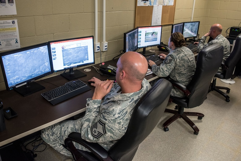 Intelligence Analysts gather infortion in the 188th Unclassified Processing, Assessment, and Dissemination (UPAD) element at Ebbing Air National Guard Base, Ark., to support Hurricane Florence response efforts Sept. 20, 2018.  The UPAD provides graphical information products to incident commanders in affected areas in order to effectively coordinate response efforts.  (U.S. Air National Guard photo by Staff Sgt. Matthew Matlock)