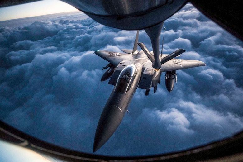 An F-15 Strike Eagle receives an aerial refueling from a KC-135 Stratotanker assigned to the 28th Expeditionary Air Refueling Squadron during a mission in support of Operation Inherent Resolve over Iraq, Sept. 12, 2018. The KC-135 provides aerial refueling to U.S. and coalition forces. The F-15 Eagle is an all-weather, extremely maneuverable, tactical fighter designed to permit the Air Force to gain and maintain air supremacy over the battlefield. (U.S. Air Force photo by Staff Sgt. Keith James)