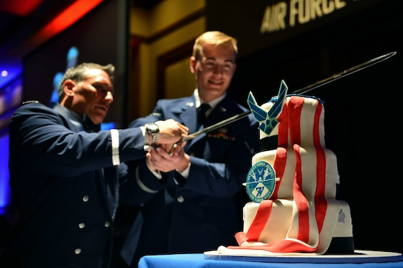 Brig. Gen. Craig Baker, 12th Air Force vice commander, and Airman 1st Class Philip, the youngest Airman in attendance, cut the 71st Air Force birthday cake at the 2018 Las Vegas Air Force Ball, Sept. 15, 2018. It is tradition for the highest ranking and youngest Airmen to cut the ceremonial cake at formal Air Force events. (U.S. Air Force photo by Airman 1st Class Haley Stevens)