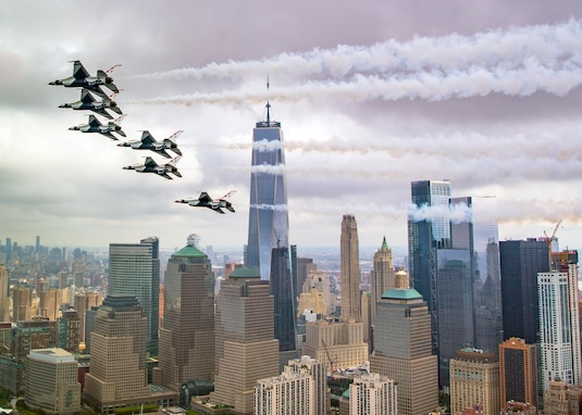 The Thunderbirds Delta formation performs a Pass in Review while flying past the Freedom Tower in New York, Sept. 17, 2018. The Thunderbirds were returning home to Nellis Air Force Base, Nev., from New Windsor, N.Y., where they performed two air shows the weekend before the flyover of the city. (U.S. Air Force photo by Staff Sgt. Ned T. Johnston)