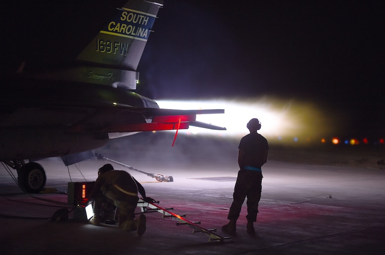 Maintenance members assigned to the 157th Expeditionary Fighter Squadron perform an afterburner run on an F-16 Fighting Falcon at an undisclosed location in Southwest Asia, Sept. 18, 2018. The F-16 is a compact, multi-role fighter aircraft. It is highly maneuverable, has proven itself in air-to-air combat and air-to-surface attack and can locate targets in all weather conditions and detect low flying aircraft in radar ground clutter. (U.S. Air Force photo by Staff Sgt. Dana J. Cable)
