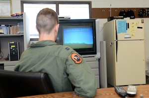 U.S. Air Force Capt. Adam Sema, 338th Combat Training Squadron student pilot, watches a safety video Sept. 14, 2018, at the LeMay Aero Club on Offutt Air Force Base, Nebraska. The services of the LeMay Aero Club are available free of charge to active-duty, guard or reserve service members, Department of Defense civilians, Department of Homeland Security personnel, family members of these individuals and retirees. The only exemption to this rule is the family members of retirees. (U.S. Air Force photo by Charles J. Haymond)
