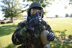 An Airman assigned to the 14th Flying Training Wing learns how to hydrate while using the M50 Joint Service General Purpose Mask during an Operational Readiness Exercise: Ability to Survive and Operate course Sept. 19, 2018, on Columbus Air Force Base, Mississippi. Airmen must stay hydrated while in Mission Oriented Protective Posture gear, but must not compromise the seal of their gas mask. The M50 has a drinking tube attached that allows Airmen to safely hydrate without risking contamination. (U.S. Air Force photo by Airman 1st Class Beaux Hebert)