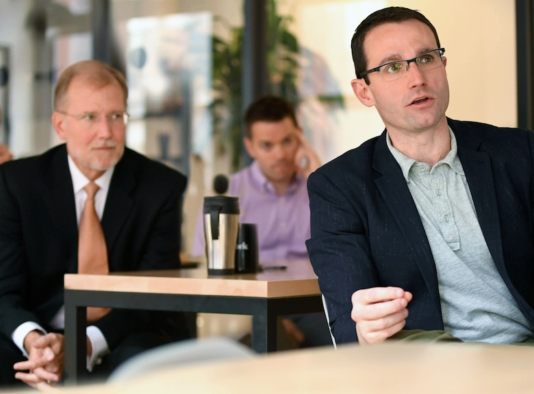 Assistant Secretary of the Air Force for Acquisition, Technology and Logistics Dr. Will Roper, right, looks on with Steven Wert, Battle Management program executive officer, Air Force Life Cycle Management Center at Hanscom Air Force Base, Mass., during a presentation at Project Kessel Run in the WeWork shared space in Boston, July 30, 2018. Roper and Wert visited the site to hear how Airmen, contractors and civilians are writing custom software applications for use at Air Operations Centers.  (U.S. Air Force photo by Todd Maki)