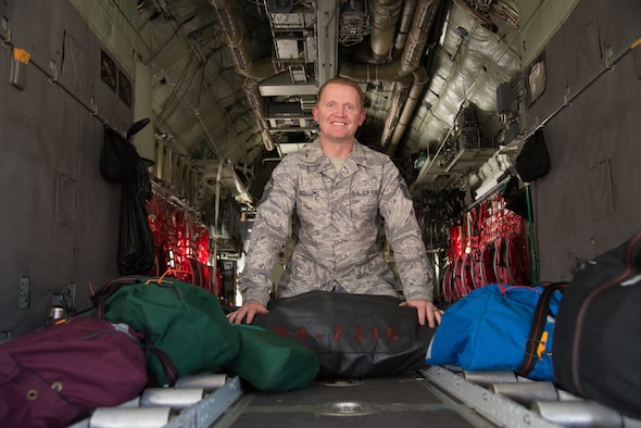 Senior Master Sgt. William Kellums, the 302nd Operations Support Squadron aircrew flight equipment superintendent, sits aboard a parked C-130 Hercules aircraft with custom-made equipment bags at Peterson Air Force Base, Colorado, Aug. 15, 2018.