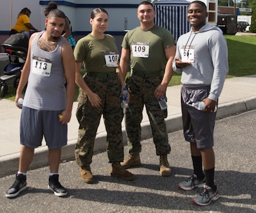 Marines from U.S. Marine Corps Forces Command prepare for  the Marine Corps Community Services 2018 Resource and Health Fair Run/Walk 5K near Naval Support Activity Hampton Roads, Sept. 21. Participants enjoyed food, music, and prizes during the event. Official U.S. Marine Corps photo by Chris Jones/Released)