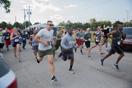 Service member and their families from the Hampton Roads, Va. area participate in the Marine Corps Community Services 2018 Resource and Health Fair Run/Walk 5K near Naval Support Activity Hampton Roads, Sept. 21. Participants enjoyed food, music, and prizes during the event. Official U.S. Marine Corps photo by Chris Jones/Released)