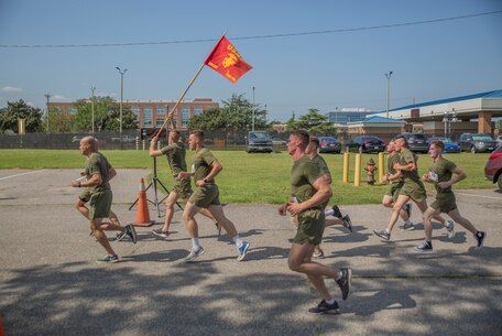 Marines from Charlie Co., Fleet Anti-terrorism Security Team, U.S. Marine Corps Security Forces Regiment finish a 5K run/Walk event as part of the Marine Corps Community Services 2018 Resource and Health Fair near Naval Support Activity Hampton Roads, Sept. 21. Marines were joined by other service members and their families to help promote physical fitness and healthy lifestyle. (Official U.S. Marine Corps photo by Chris Jones/Released)