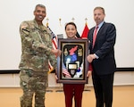 DLA Energy at Korea Unchong Yu receives a plaque in recognition of the USFK Administrator of the Year. Presented by United Nations Command/Combined Forces Command/United States Forces Korea Commander U.S. Army Gen. Vincent Brooks and senior civilian Craig Deatrick. Courtesy photo (Editors note: Milton Coleman not pictured)