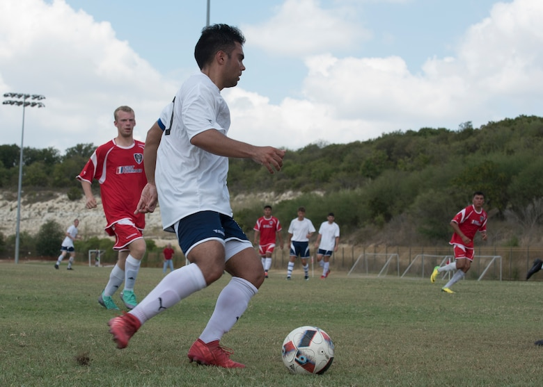 Staff Sgt. Joseph Haug, Holloman's Varsity Soccer Team captain, dribbles the ball Sept. 2, at the South Texas Area Regional Soccer Complex in San Antonio, Texas, during the 2018 Defender's Cup. Haug formerly played for the Air Force Armed Forces Men's Soccer Team. (U.S. Air Force photo by Airman Autumn Vogt)
