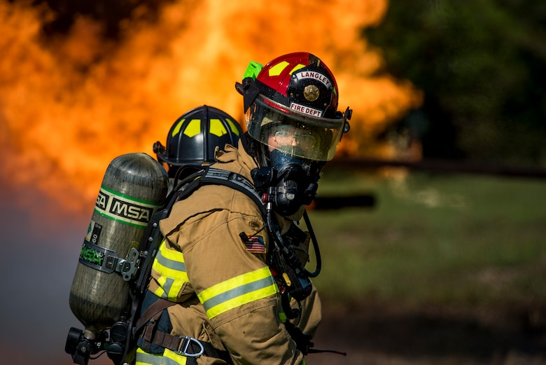 U.S. Air Force Staff Sgt. Isaac Sunnock, 633rd Civil Engineer Squadron lead firefighter, participates in a live-fire training exercise at Joint Base Langley-Eustis, Virginia, Sept. 19, 2018.