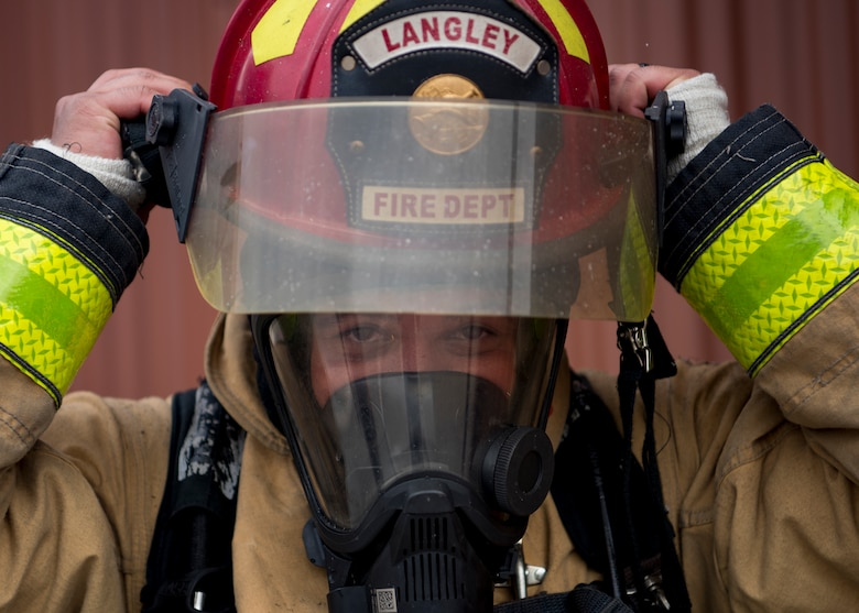 U.S. Air Force Staff Sgt. Jose Cancel, 633rd Civil Engineer Squadron lead firefighter, participates in a fire training exercise at Joint Base Langley-Eustis, Virginia, Sept. 20, 2018.