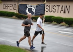 U.S. Air Force Tech. Sgt. Kurt Kanzler, a precision guidance munitions production supervisor with the 51st Munitions Squadron, runs with a prisoner of war and missing in action flag during a 24-hour vigil run at Osan Air Base, Republic of Korea, Sept. 21, 2018. The main purpose of POW/MIA Remembrance Day is to pay tribute and honor the sacrifices of prisoners of war and those who are missing in action.