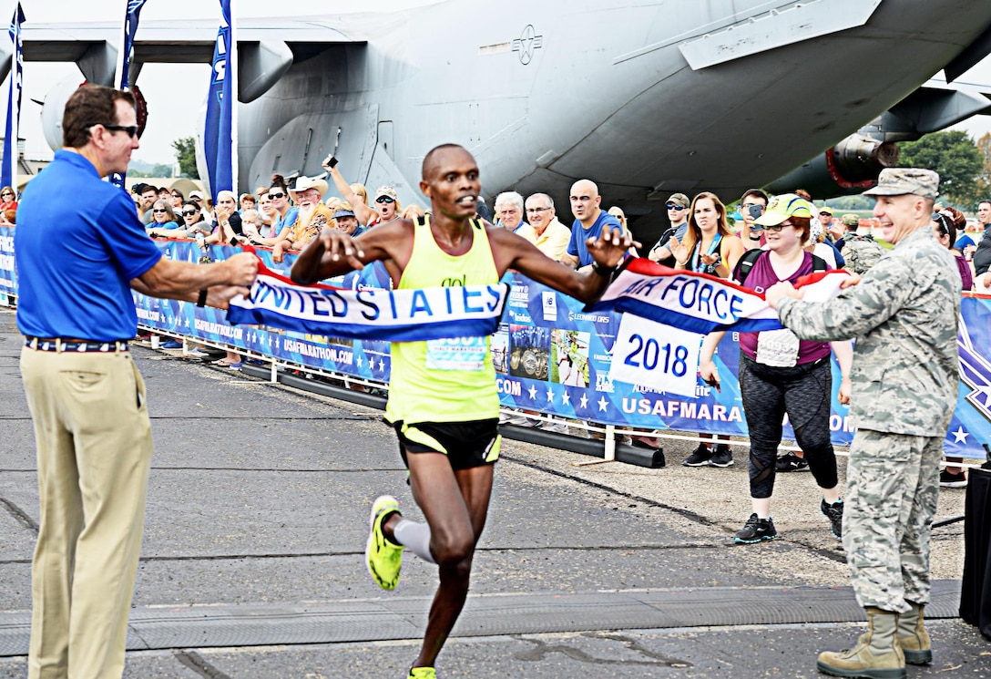 U.S. Air Force Airman 1st Class Daniel Kirwa, an aerospace medical technician assigned to the 6th Medical Operations Support Squadron, crosses the finish line in first place during the Air Force half marathon race held at Wright-Patterson Air Force Base, Ohio, Sept. 15, 2018. Kirwa finished with a time of 1:12:05, which is a 5:32 pace for 13 miles.