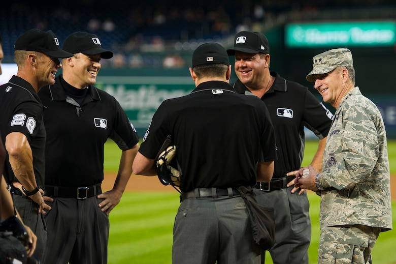 The General talks with baseball officials.