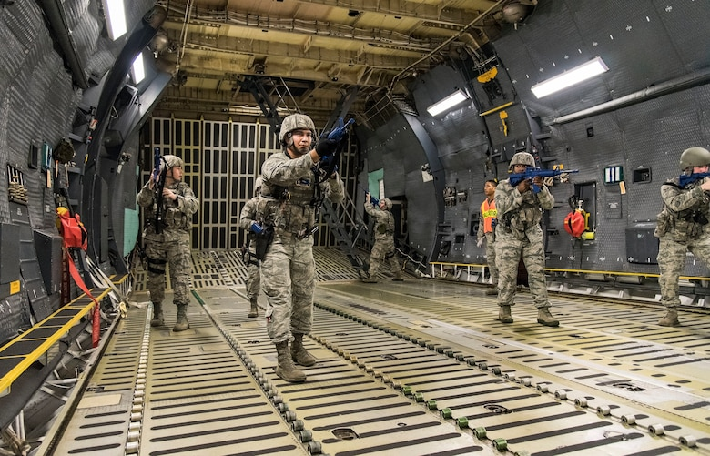 A 436th Security Forces Squadron response force team clears the C-5M Super Galaxy cargo compartment after entering the aircraft from a rear door Sept. 17, 2018, on Dover Air Force Base, Del. The response force team located and neutralized the mock hijacker who was holding mock hostages in the aircraft's troop compartment. (U.S. Air Force photo by Roland Balik)