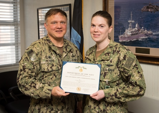 PANAMA CITY, Florida - Lt. Elizabeth Janca is awarded the Navy and Marine Corps Commendation Medal for Meritorious Service as the Airfield Manager during her tour aboard Naval Surface Warfare Center Panama City Division (NSWC PCD) by Commanding Officer Capt. Aaron Peters (left) Sept. 21, 2018. In addition, Janca received a Letter of Appreciation for her leadership, outstanding efforts and achievements as a NSWC PCD Leadership Diversity Change Agent. U.S. Navy photo by Anthony Powers
