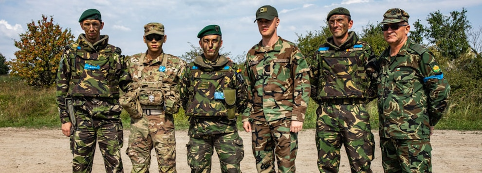 Soldiers from The United States, Romania, Moldova and Bulgaria pope for a photo during Rapid Trident 18 held at Yavoriv CTC, Ukraine, Sept. 10.
