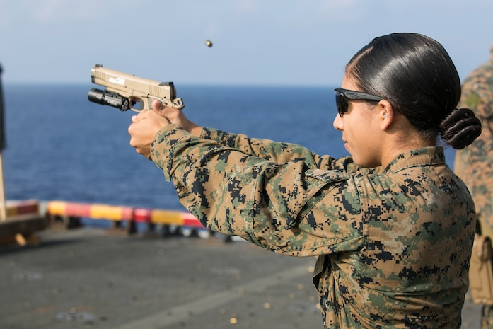 1st Lt. Samantha Rosales, a logistics planner with the 31st Marine Expeditionary Unit, fires an M1911 .45-caliber pistol during marksmanship training aboard the amphibious assault ship USS Wasp (LHD 1) while underway in the East China Sea, Sep. 21, 2018. Rosales, a native of San Clemente, California, graduated San Clemente High School June 2011; she commissioned June 2016. The Amphibious Reconnaissance Platoon Marines carry a variety of tactical weapons, including the M1911, and specialize in close-quarters battle tactics during amphibious operations.  The 31st MEU, the Marine Corps' only continuously forward-deployed MEU, provides a flexible force ready to perform a wide-range of military operations in the Indo-Pacific region.