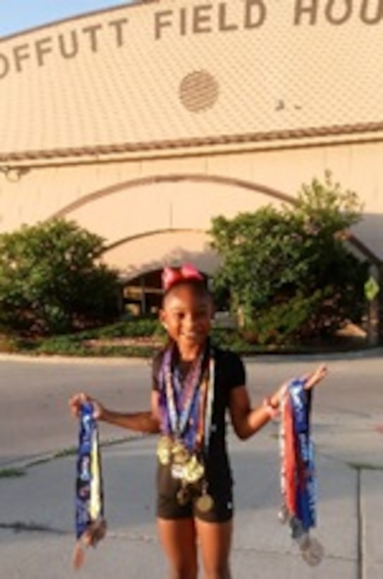 Jaiya Patillo, a Junior Olympian, poses for a photo outside the Offutt Field House on Offutt Air Force Base, Nebraska, 2018. After spending a considerable amount of time training at Offutt, Jaiya chose to represent the Air Force on her track apparel for Amateur Athletic Union track meets. (Courtesy Photo)