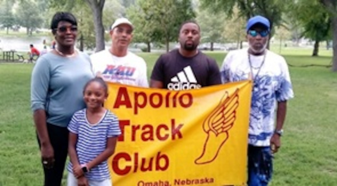 "Jaiya Patillo, a Junior Olympian, poses for a photo with her coaches Shunta Paul, left, Nicki Paul, Marlon Brewer, and Elmer ""Budgie"" Reeves. Patillo does much of her training at Offutt Air Force Base. (Courtesy Photo)"