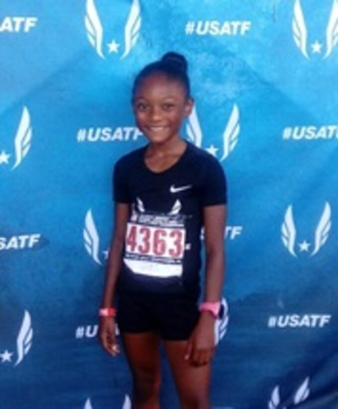 Jaiya Patillo, a Junior Olympian, poses for a photof at the 2018 USA Track & Field National Junior Olympics July 2018, at Greensboro, North Carolina. Patillo does much of her trtaining at Offutt Air Force Base. As of Sept. 21, 2018, her personal best times in her race categories were 14.32 seconds in the 100-meter, 28.53 seconds in the 200-meter, and 64.56 seconds in the 400-meter. (Courtesy Photo)