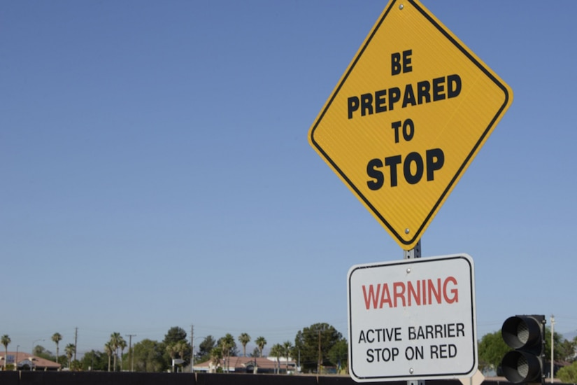 "A yellow traffic sign reads ""be prepared to stop""."
