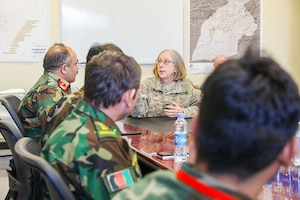 Navy Capt. Cynthia Gantt, commander of the NATO Role III Multinational Medical Unit, talks to the Kandahar Regional Military Hospital commander at the Role III in Kandahar Airfield, Afghanistan, Sept. 17, 2018. Medical officers from Role III and KRMH conduct routine case studies and medical training. Army photo by Staff Sgt. Neysa Canfield