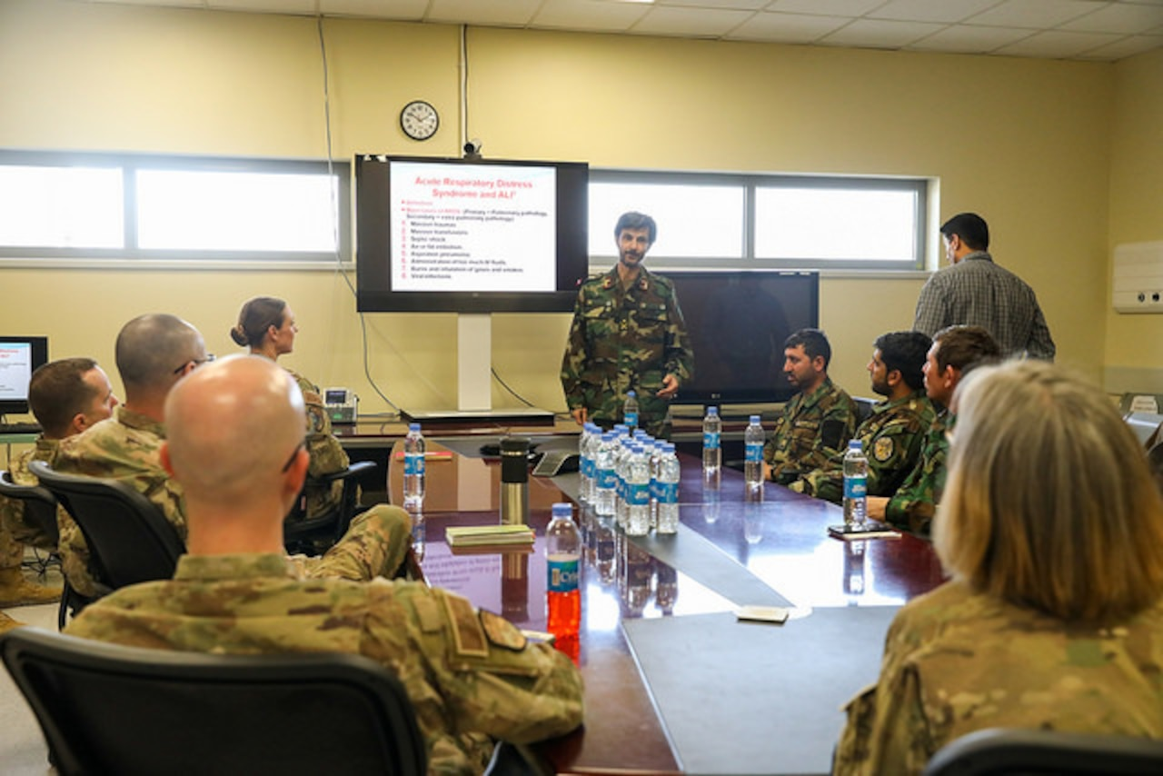 An Afghan medical officer with Kandahar Regional Military Hospital goes over a patient case study during a meeting between KRMH and NATO Role III Multinational Medical Unit medical staff at Kandahar Airfield, Afghanistan, Sept. 17, 2018. Army photo by Staff Sgt. Neysa Canfield