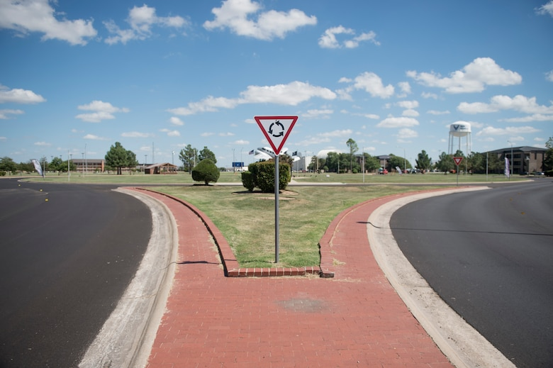 A warning sign alerts drivers to a traffic circle where roads were newly paved