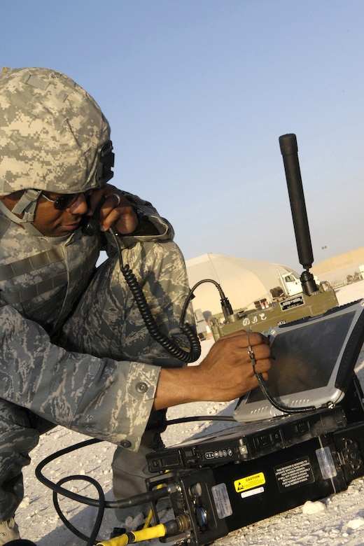 Master Sgt. Chris Thompson, chief joint terminal attack controller instructor at Fort Carson, Colo., deployed to the 704th Expeditionary Support Squadron at Al Udeid Air Base, Qatar, communicates via the remotely operated video enhanced receiver on Sept. 21, 2007.