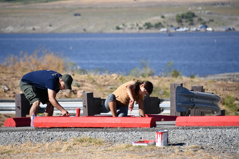 Volunteers paint curb stops during the National Public Lands Day event held at the U.S. Army Corps of Engineers Sacramento District's Success Lake on September 22, 2018.
