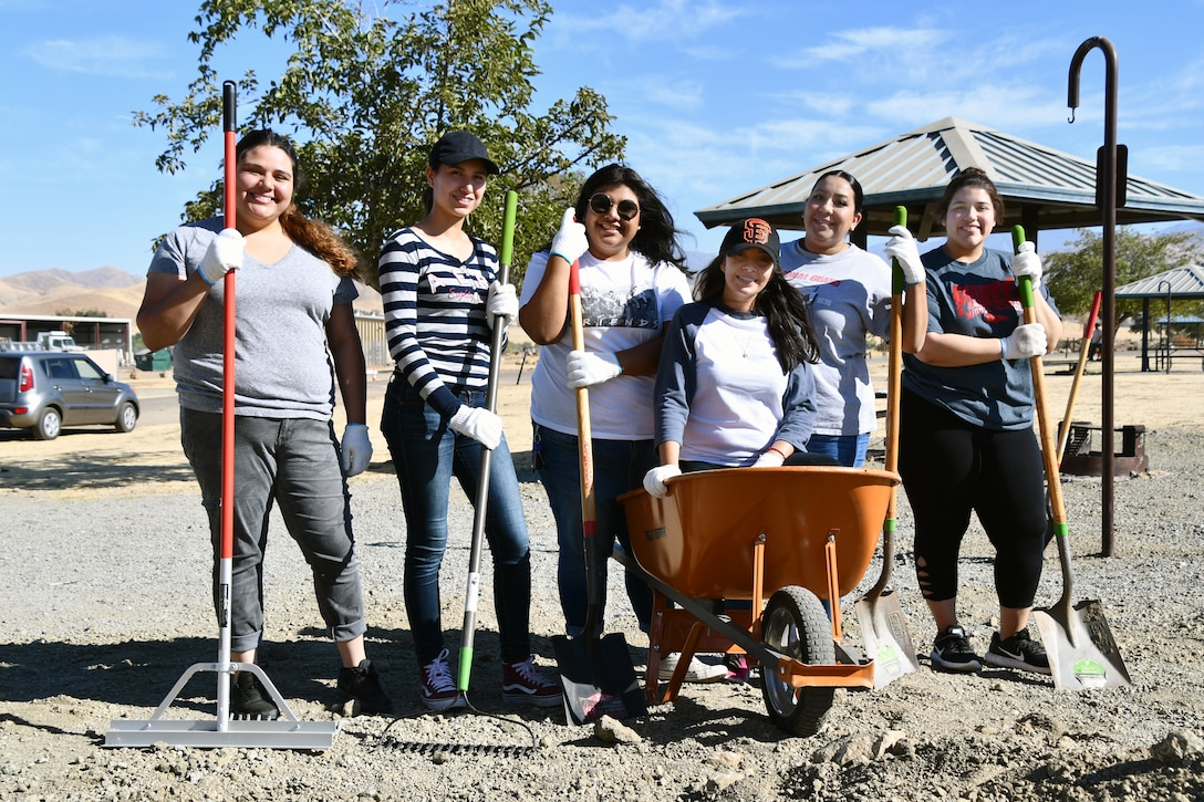 A group of students from Porterville College do the hard work involved in spreading dirt at various locations throughout Success Lake during National Public Lands Day at the U.S. Army Corps of Engineers Sacramento District's Success Lake on September 22, 2018.