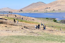 Volunteers fan out across a hillside to pick up trash during the National Public Lands Day event held at the U.S. Army Corps of Engineers Sacramento District's Success Lake on September 22, 2018.