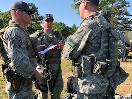 The Washington Air National Guard marksmanship team discusses course of fire for next rifle range competition at the 47th Annual Winston P. Wilson Championship, Robinson Maneuver Training Center, Arkansas, April 30, 2018.  The annual events, hosted by the National Guard Marksmanship Training Center April 29-May 4, 2018, offer Servicemembers from the National Guard and international community an opportunity to test marksmanship skills in a battle-focused environment. (U.S. Air National Guard photo by Staff Sgt. Hope Funderburk)