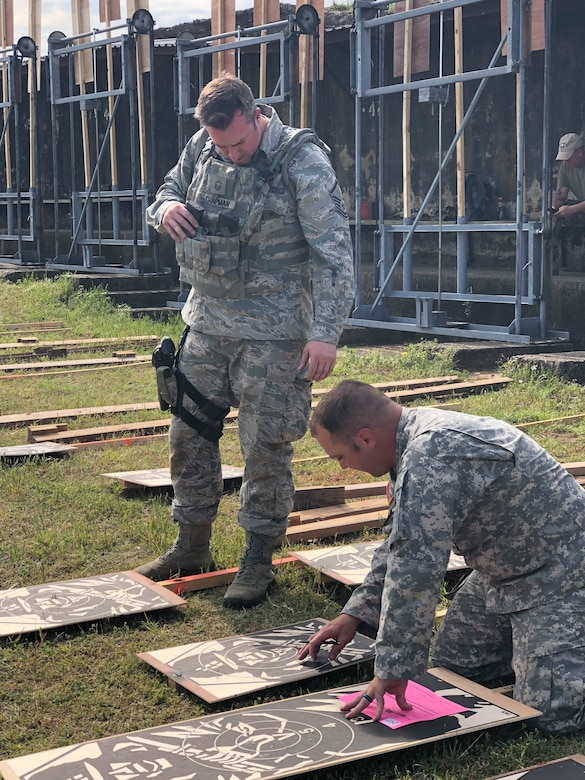 Master Sgt. Michael Chapman, 194th Security Forces Squadron, verifies scores with Army personnel during the 47th Annual Winston P. Wilson Championship, Robinson Maneuver Training Center, Arkansas, May 1, 2018.  The annual events, hosted by the National Guard Marksmanship Training Center April 29-May 4, 2018, offer Servicemembers from the National Guard and international community an opportunity to test marksmanship skills in a battle-focused environment. (U.S. Air National Guard photo by Staff Sgt. Hope Funderburk)