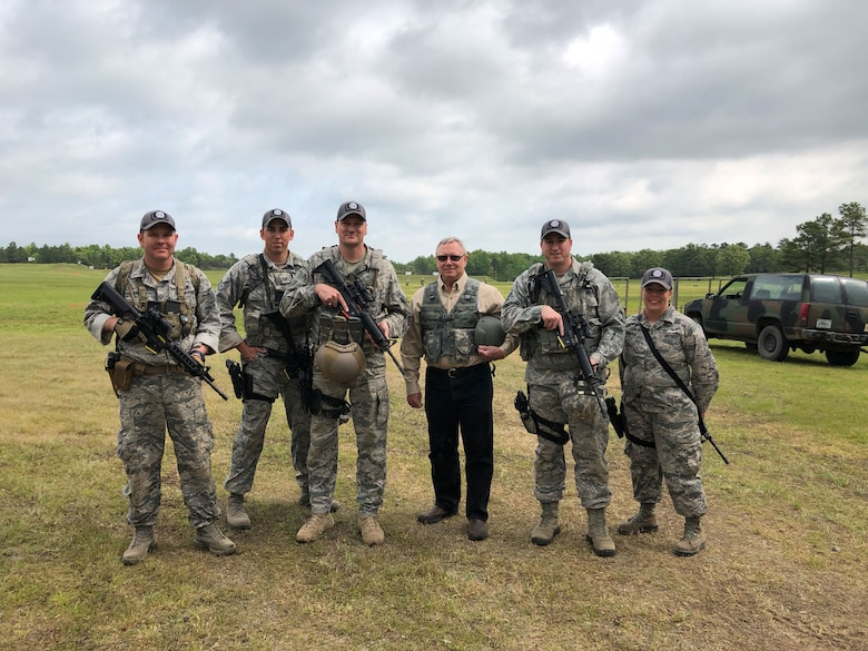 Master Sgt. Christopher Martin, left to right, 242nd Combat Communications Squadron first sergeant and team captain, Staff Sgt. Caleb Gutting, 141st Security Forces Squadron, Maj. Eric Manewal, 194th Wing, Gen. Frank Glass, 28th Chief of National Guard Bureau, Master Sgt. Michael Chapman, 194th Security Forces Squadron, and Staff Sgt. Hope Funderburk, 225th Support Squadron, pose for team picture during the  47th Annual Winston P. Wilson Championship, Robinson Maneuver Training Center, Arkansas, May 2, 2018.  The annual events, hosted by the National Guard Marksmanship Training Center April 29-May 4, 2018, offer Servicemembers from the National Guard and international community an opportunity to test marksmanship skills in a battle-focused environment. (U.S. Air National Guard photo by Staff Sgt. Hope Funderburk)