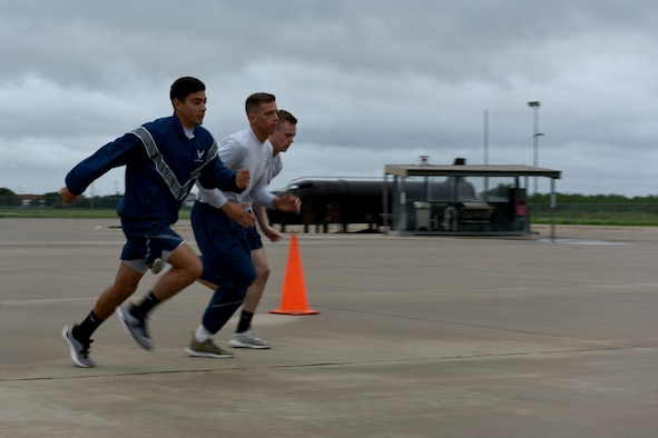 """Airman Jake Peterson, Airman 1st Class Garrett Rivett and Airman Haden Stoner, 312th Training Squadron students, begin the Blood, Sweat and Stairs competition at the Louis F. Garland Department of Defense Fire Academy on Goodfellow Air Force Base, Texas, Sept. 22, 2018. Participants could run as individuals or as 3-person teams. Peterson, Rivett and Stoner formed team """"Give er' the Gun.""""(U.S. Air Force photo by Senior Airman Randall Moose/Released)"""
