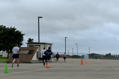 Participants run the final stretch of the Blood, Sweat and Stairs competition at the Louis F. Garland Department of Defense Fire Academy on Goodfellow Air Force Base, Texas, Sept. 22, 2018. The purpose of the event is to remind participants of the sacrifices of the emergency responders on September 11, 2001. (U.S. Air Force photo by Senior Airman Randall Moose/Released)