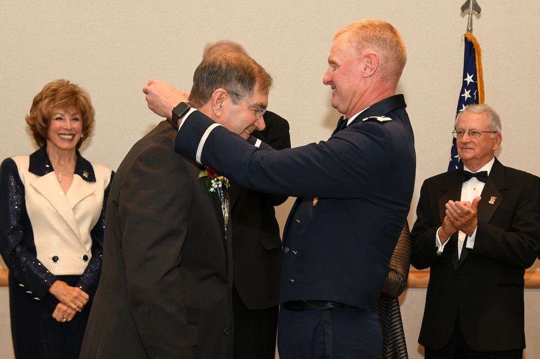 Bob Stevenson, Mayor of Layton City, Utah, receives the Hill Air Force Base Community Wingman Award from Col. Jon Eberlan, 75th Air Base Wing commander, at Hill's Air Force Ball Sept. 22. The annual honor recognizes a community member who has made a significant service contribution to the installation. (U.S. Air Force photo by Cynthia Griggs)
