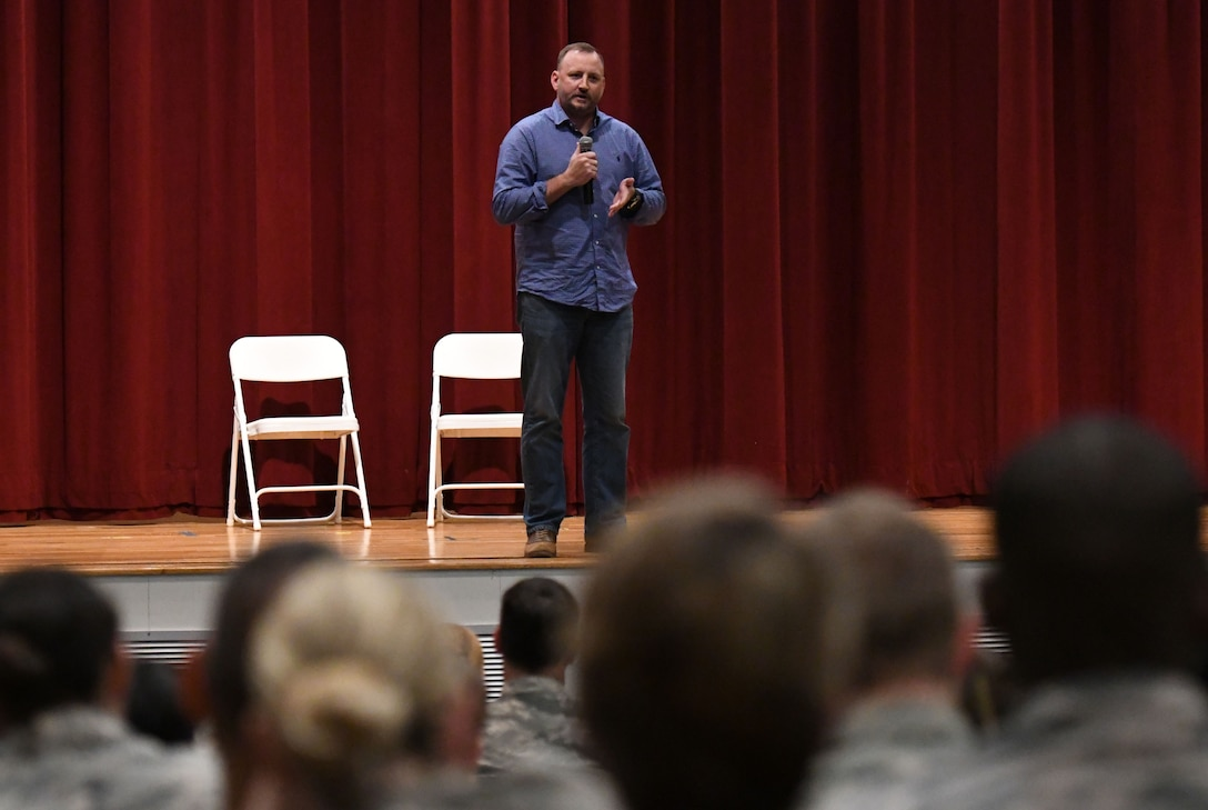 Retired U.S. Army Engineer Kenny Craig speaks during a 'Profiles in Courage' story-telling event at the Welch Theater at Keesler Air Force Base, Mississippi, Sept. 20, 2018. In recognition of suicide prevention and awareness month, military members shared their stories of bravery, strength and overcoming adversity with Keesler personnel. (U.S. Air Force photo by Kemberly Groue)