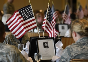 Center pieces featuring prisoners of war are displayed during the POW/MIA Remembrance Luncheon at the Bay Breeze Event Center at Keesler Air Force Base, Mississippi, Sept. 21, 2018. The event, hosted by the Air Force Sergeants Association, was held to raise awareness and to pay tribute to all prisoners of war and those military members still missing in action. (U.S. Air Force photo by Kemberly Groue)
