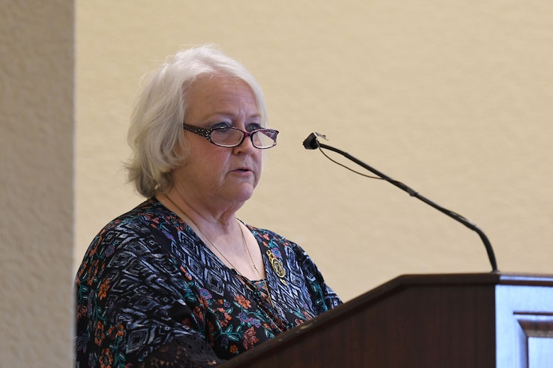 Diane Moore, daughter of U.S. Air Force Chief Master Sgt. Thomas Moore, POW/MIA Vietnam, delivers remarks during the POW/MIA Remembrance Luncheon at the Bay Breeze Event Center at Keesler Air Force Base, Mississippi, Sept. 21, 2018. The event, hosted by the Air Force Sergeants Association, was held to raise awareness and to pay tribute to all prisoners of war and those military members still missing in action. (U.S. Air Force photo by Kemberly Groue)