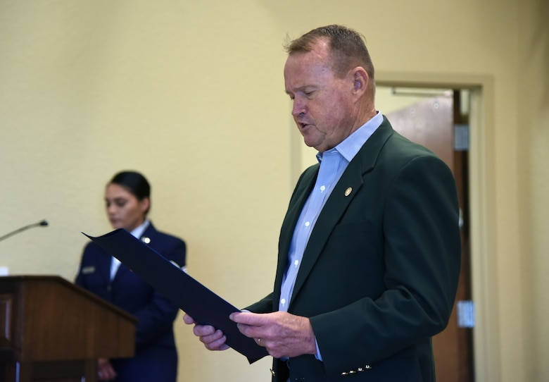 "Mike Leonard, Biloxi city administrator, reads a ""Prisoner Of War and Missing In Action Remembrance Day in the City of Biloxi"" proclamation during the POW/MIA Remembrance Luncheon at the Bay Breeze Event Center at Keesler Air Force Base, Mississippi, Sept. 21, 2018.The event, hosted by the Air Force Sergeants Association, was held to raise awareness and to pay tribute to all prisoners of war and those military members still missing in action. (U.S. Air Force photo by Kemberly Groue)"