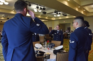 Keesler Airmen participate in a POW/MIA table ceremony during the POW/MIA Remembrance Luncheon at the Bay Breeze Event Center at Keesler Air Force Base, Mississippi, Sept. 21, 2018. The event, hosted by the Air Force Sergeants Association, was held to raise awareness and to pay tribute to all prisoners of war and those military members still missing in action. (U.S. Air Force photo by Kemberly Groue)